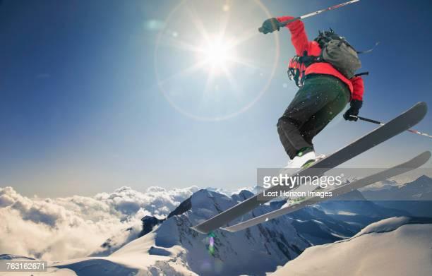 Skier jumping on ski slope, Chamonix, Mont Blanc, Rhone Alpes, France, Europe