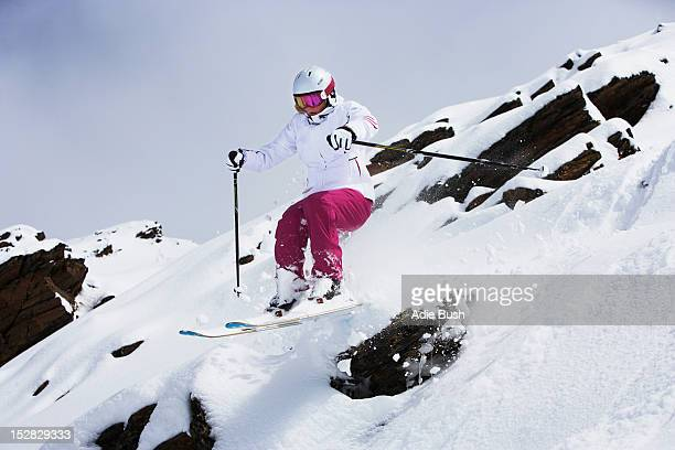 skier jumping on snowy slope - female skier stock pictures, royalty-free photos & images