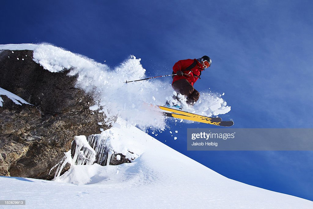 Skier jumping on snowy slope : Stock Photo