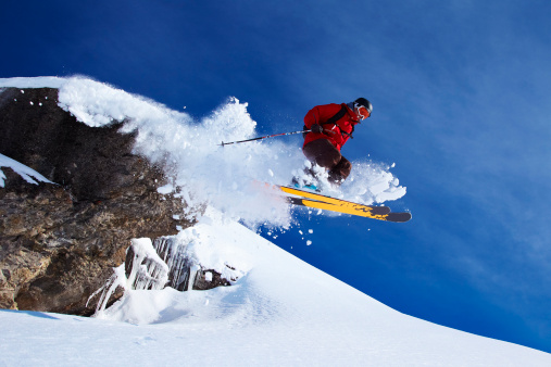 Skier jumping on snowy slope 152829913