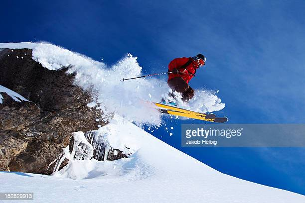 skier jumping on snowy slope - winter sport stock pictures, royalty-free photos & images
