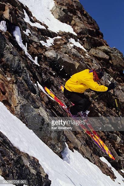 Skier jumping over rocks, Whistler British Columbia, Canada