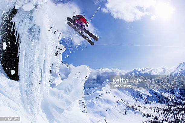 Skier jumping snowy slope