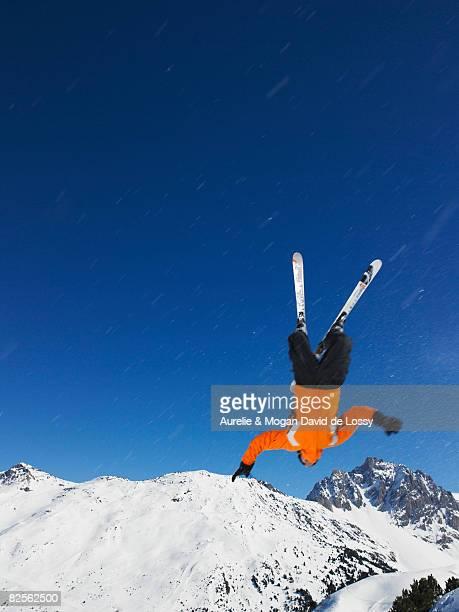 Skier jumping upside down