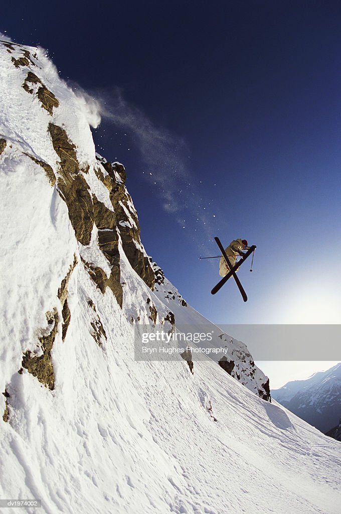 Skier Jumps From Rock Face, Coast Mountain, Whistler, British Columbia, Canada : Stock Photo