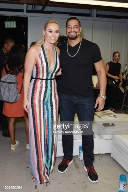 Skier Lindsey Vonn and wrestler Roman Reigns pose in the Green Room at the Nickelodeon Kids' Choice Sports 2018 at Barker Hangar on July 19 2018 in...