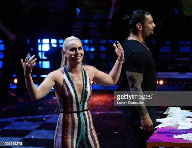 Skier Lindsey Vonn and WWE wrestler Roman Reigns participate in a challange onstage during the Nickelodeon Kids' Choice Sports 2018 at Barker Hangar...