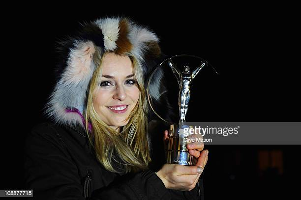 Skier Lindsey Vonn of the United States poses with her award for the 'Laureus World Sportswoman of the Year' during the 2011 Laureus World Sports...