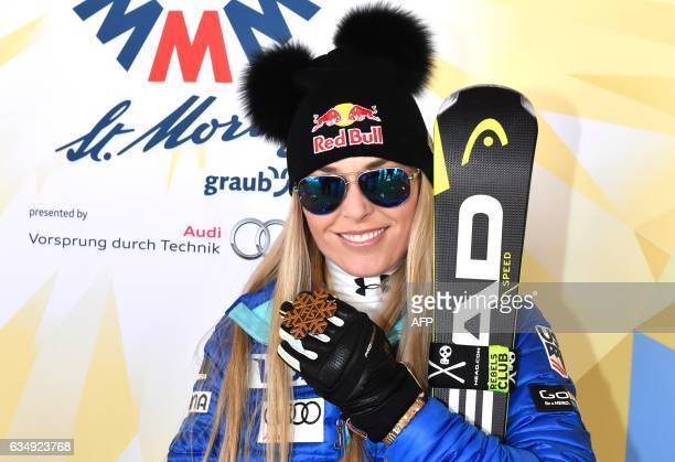 US skier Lindsey Vonn poses with her bronze medal after the women's downhill race at the 2017 FIS Alpine World Ski Championships in St Moritz on...