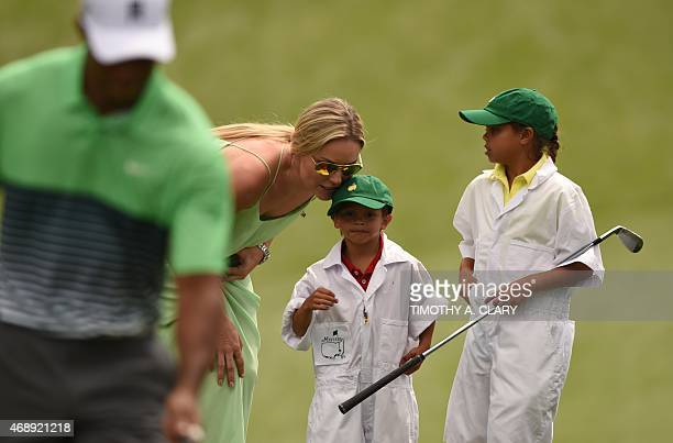 US Skier Lindsey Vonn speaks to Charlie Axel Woods and Sam Alexis Woods children of US player Tiger Woods during the Par 3 competition on April 8 at...