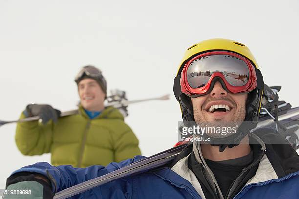 Skier looking up at mountain