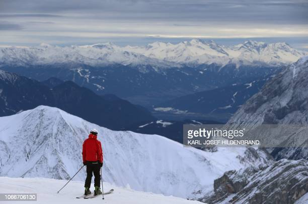A skier looks at the panorama at the Zugspitze southern Germany on November 30 2018 as the skiing season starts at the Zugspitze / Germany OUT