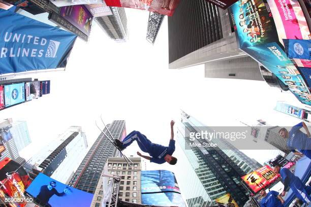 A skier makes a jump during the 100 Days Out 2018 PyeongChang Winter Olympics Celebration Team USA in Times Square on November 1 2017 in New York City