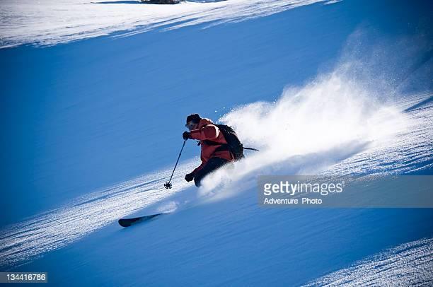 Skier Making Powder Turns in Backcountry