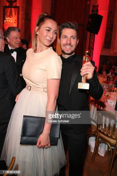 Skier Marcel Hirscher and his wife Laura Hirscher poses with his award for the best TV moment during the ROMY award at Hofburg Vienna on April 13,...