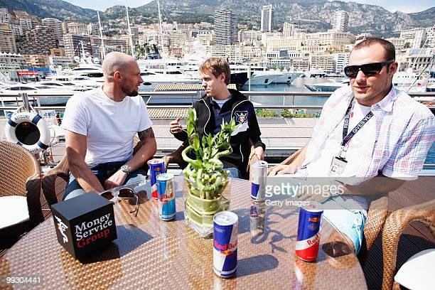 Skier Marco Buchel Sebastian Vettel of Germany and Red Bull Racing and skier Aksel Lund Svindal are seen on the Red Bull Energy Station during...