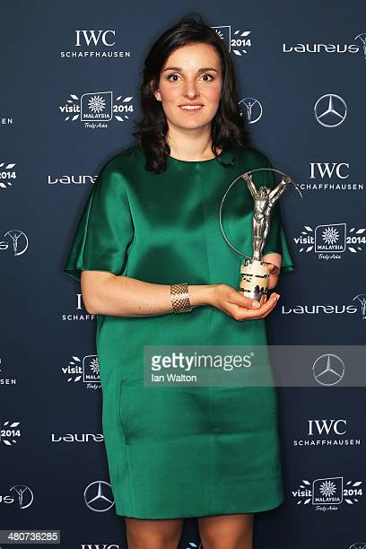 Skier Marie Bochet winner of the Laureus World Sportsperson of the Year with a Disability award poses with their trophy during the 2014 Laureus World...