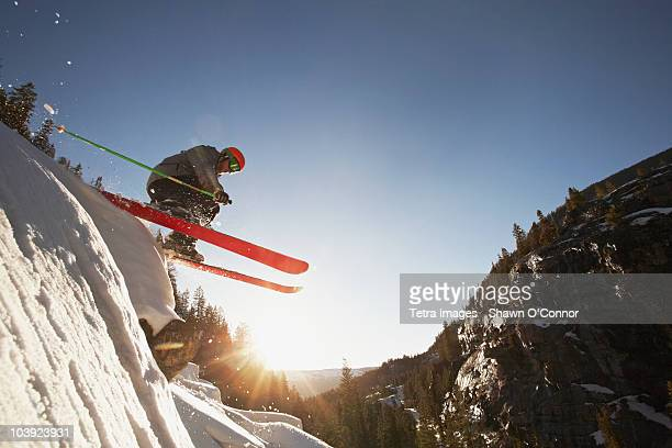 skier mid jump in aspen colorado - ski jumping stock pictures, royalty-free photos & images