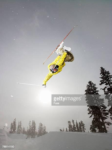 skier mid-air during jump - スキージャンプ ストックフォトと画像