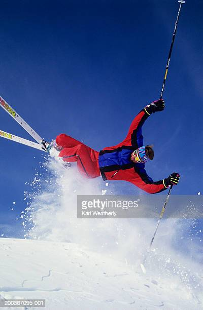 Skier mid-air, pole-plant