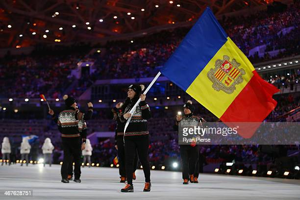 Skier Mireia Gutierrez of the Andorra Olympic team carries her country's flag during the Opening Ceremony of the Sochi 2014 Winter Olympics at Fisht...