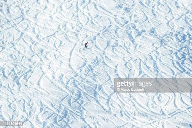 Skier off-track skiing on a ski slope