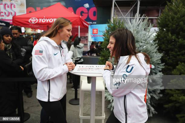 Skier Oksana Masters and skier Danelle Umstead sign autographs during the 100 Days Out 2018 PyeongChang Winter Olympics Celebration Team USA in Times...