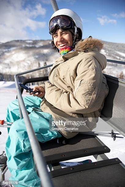skier on chairlift - avon colorado stock photos and pictures