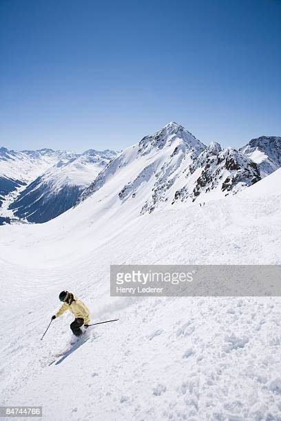 skier on mountain side in swiss alps - davos stock pictures, royalty-free photos & images