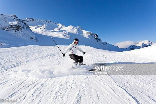 Esquiador en piste