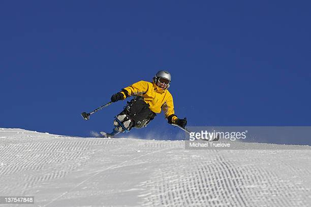 Skier on snowy mountain slope