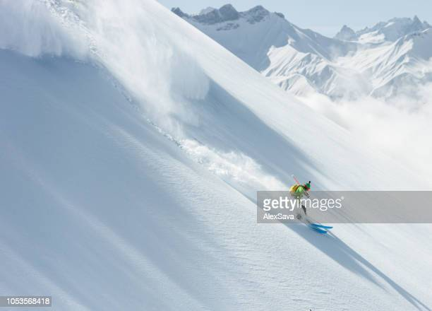 skier on the slope - snowcapped mountain stock pictures, royalty-free photos & images