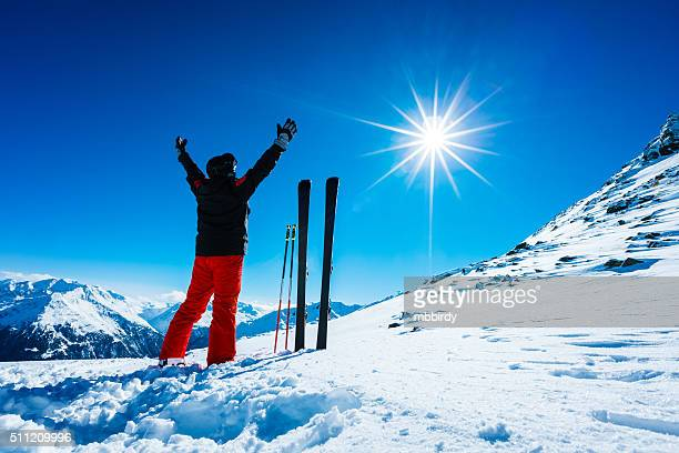 Skier on top of ski resort