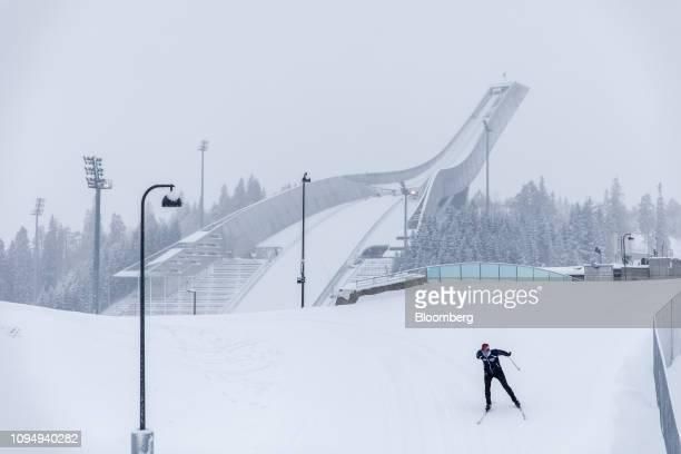 A skier passes the Holmenkollbakken ski jumping hill in the Holmenkollen neighborhood of Oslo Norway on Wednesday Feb 6 2019 Norway will release its...