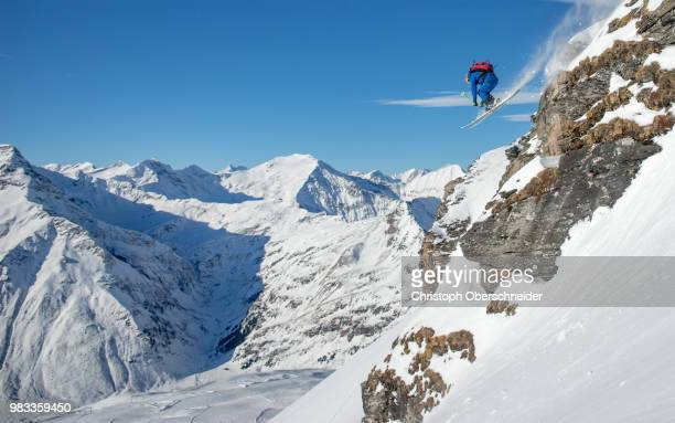 a skier performing a jump on a mountain. - スキージャンプ ストックフォトと画像