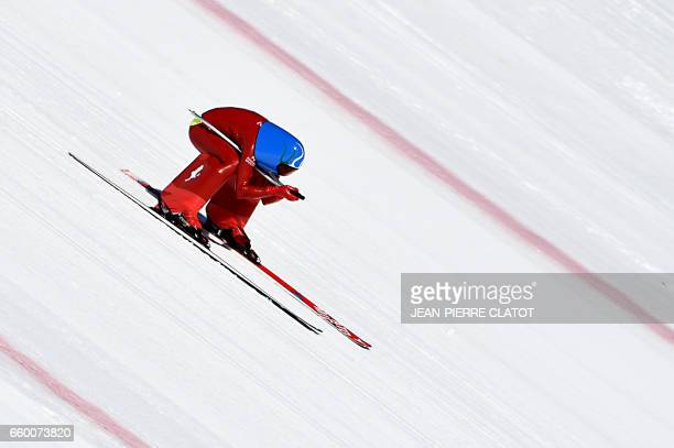 TOPSHOT A skier performs speed skiing on the Chabriere ski slope in Vars on March 29 2017 / AFP PHOTO / JEANPIERRE CLATOT