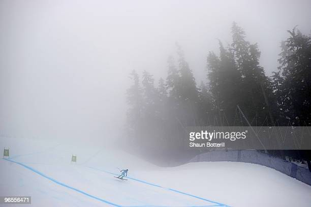 Skier practices in heavy fog during the Men's Downhill skiing 1st training run ahead of the Vancouver 2010 Winter Olympics on February 10, 2010 in...