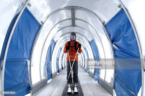 A skier rides on a carpet lift at the Niseko Hanazono resort operated by Nihon Harmony Resorts KK in Kutchan Hokkaido Japan on Sunday Feb 15 2015 The...