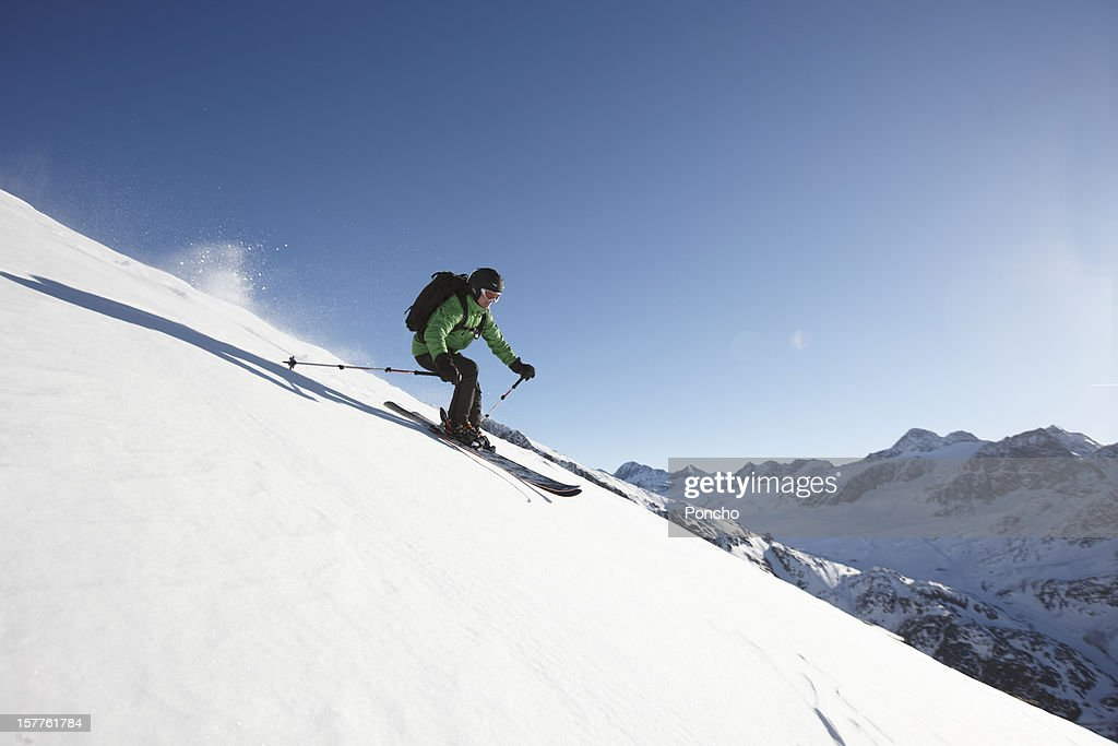 Skier riding downhill : Stock Photo