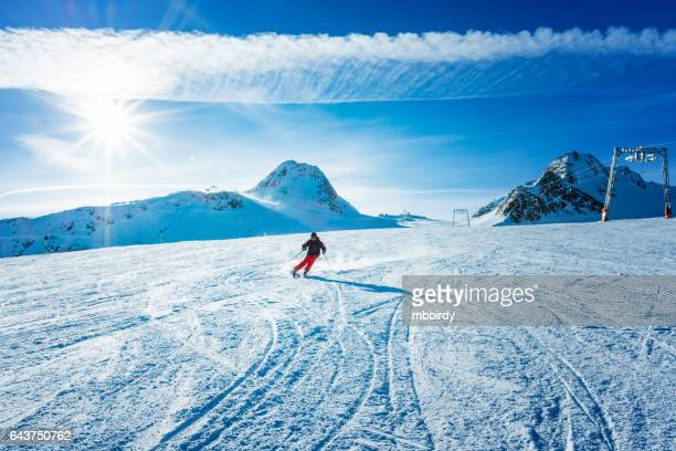 skier skiing down the slope of ski resort - solden stock pictures, royalty-free photos & images
