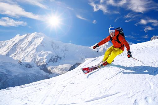 Skier skiing downhill against Matterhorn peak in Switzerland 598215726