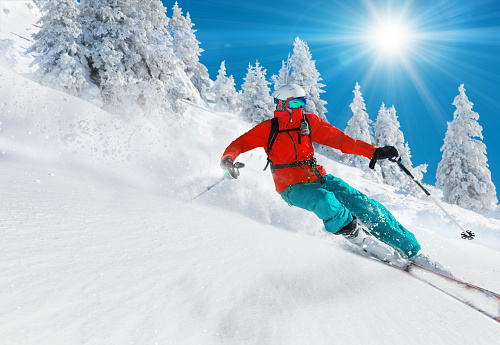Skier skiing downhill in high mountains 854396336