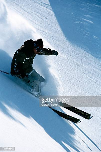 A skier skiing downhill.