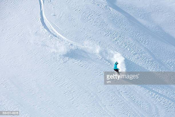 skier skiing off-piste on a beatiful mountain slope - winter sport stock pictures, royalty-free photos & images