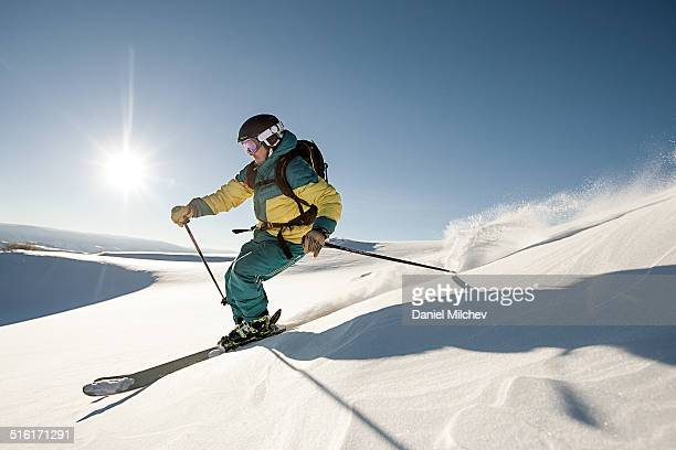 Skier skiing on a perfect day.