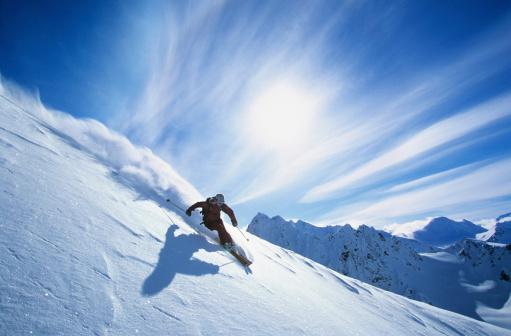 Skier Skiing On Mountain Slope 462208827