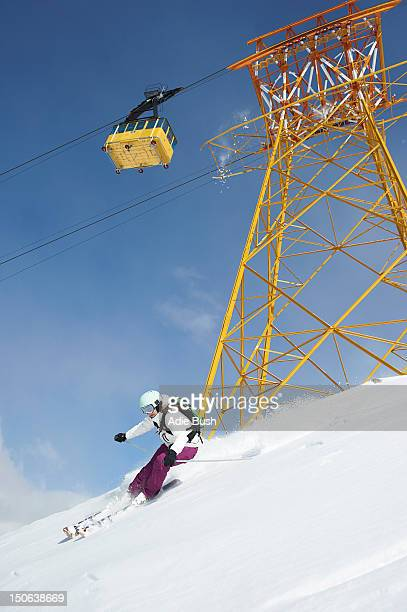 skier skiing on snowy slope - ski pole stock pictures, royalty-free photos & images