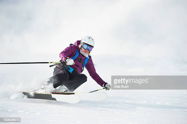 skier skiing on snowy slope - ボルミオ ストックフォトと画像