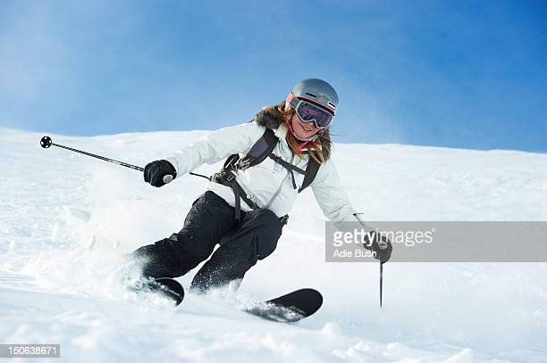 skier skiing on snowy slope - female skier stock pictures, royalty-free photos & images
