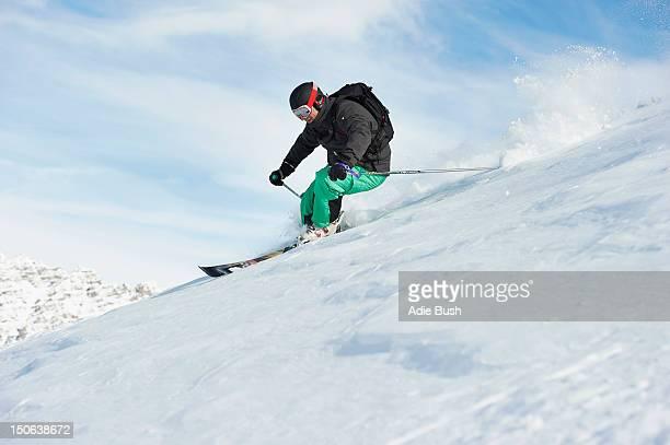Skier skiing on snowy slope